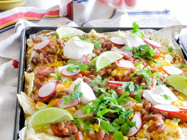 Healthy, low-carb, super easy loaded cauliflower nachos recipe! Use cauliflower as a meat substitute on these simple vegetarian nachos; it's so good, I even surprised myself!