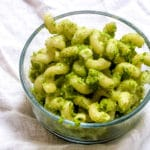 Broccoli pesto is a simple way to add more vegetables into your (or your kids') diet! Simply swap out traditional basil with 'riced' broccoli. Here's how.