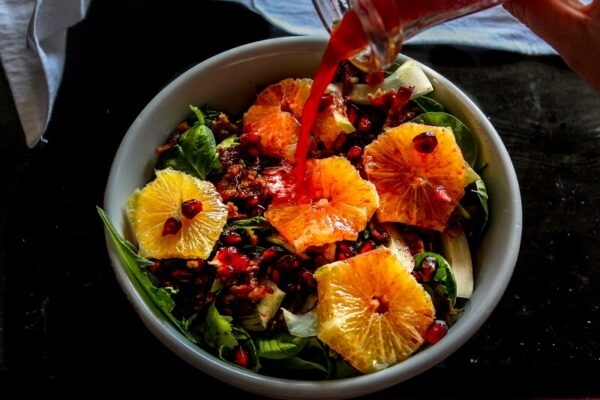 This is such a tasty, crunchy winter salad! I like how there's pomegranate seeds both in the salad and the dressing. PLUS she has a GREAT video on how to open a pomegranate without getting juice everywhere- really helpful!
